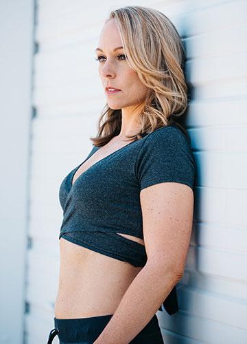 Kristine in a sports bra